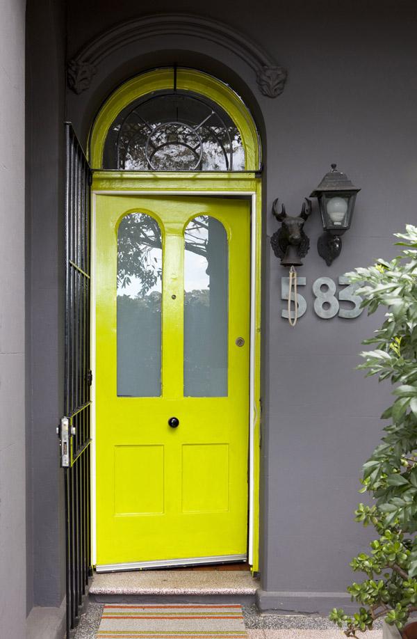 yellow door grey walls