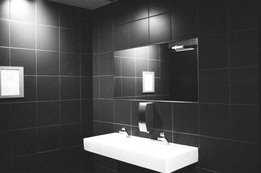 A dark painted bathroom