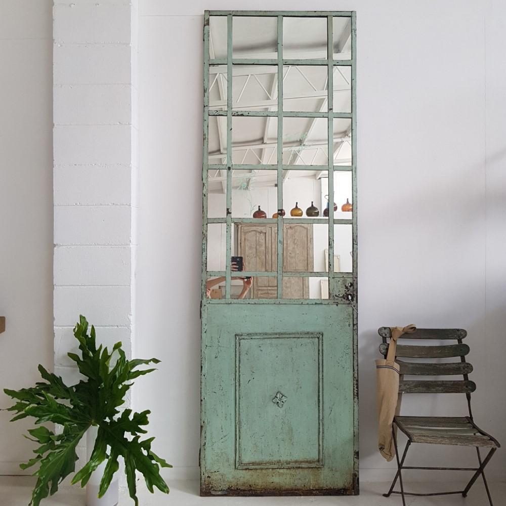 mirrored vintage French iron door