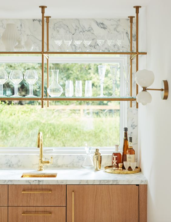 glass and brass window shelving