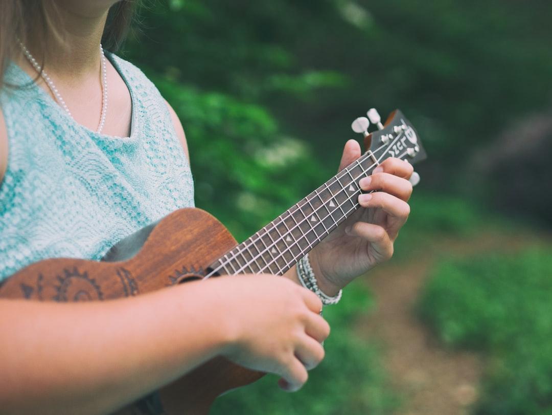 Person playing a uke