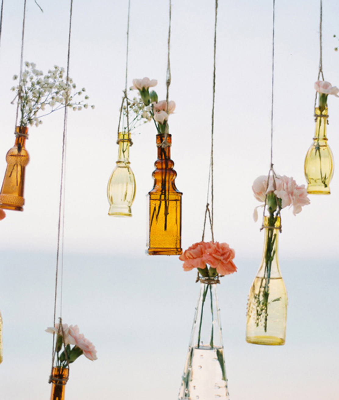 flowers in jars hanging for wedding decoration