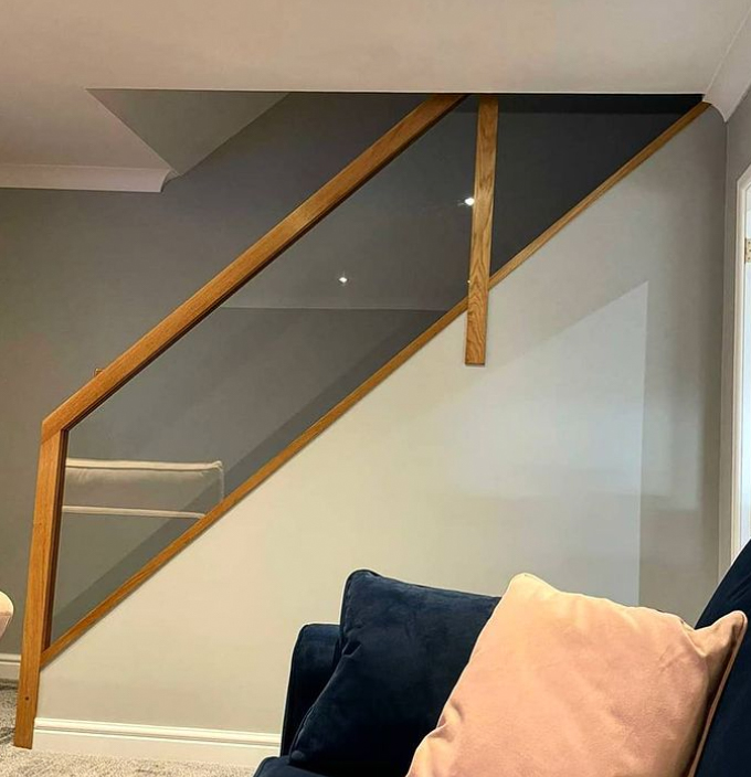 timber and glass banister