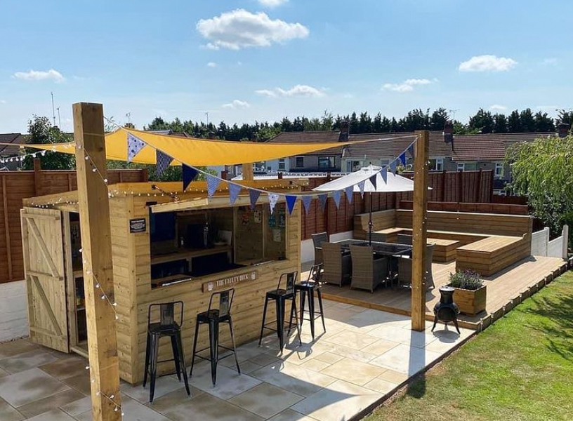 large backyard with patio and garden bar