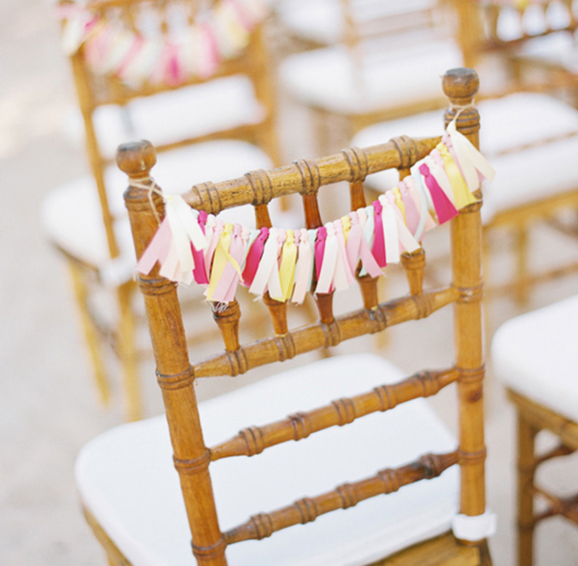 colourful tassels on seats at wedding ceremony