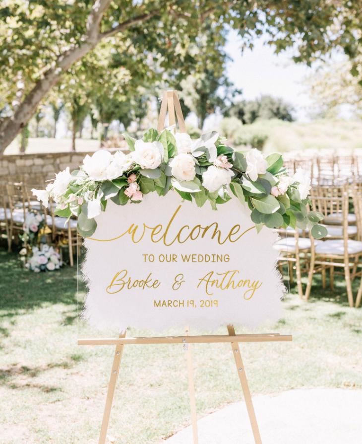 Acrylic welcome sign at wedding ceremony