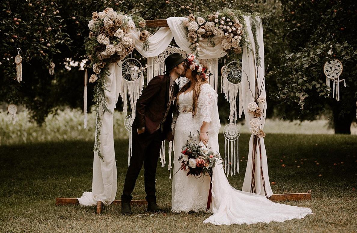 Macrame arbour at wedding ceremony
