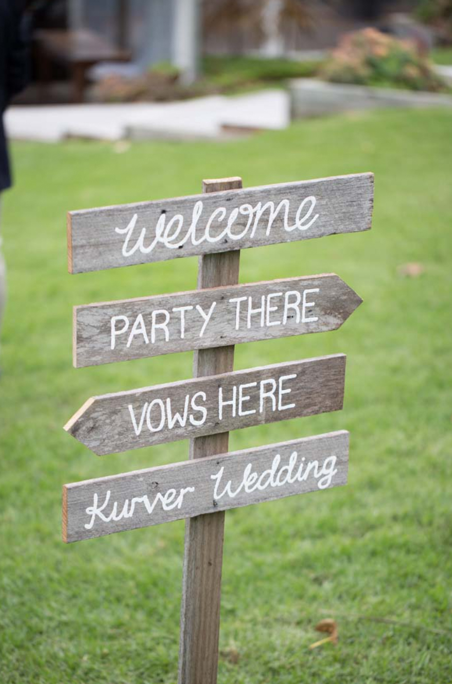 direction sign at wedding