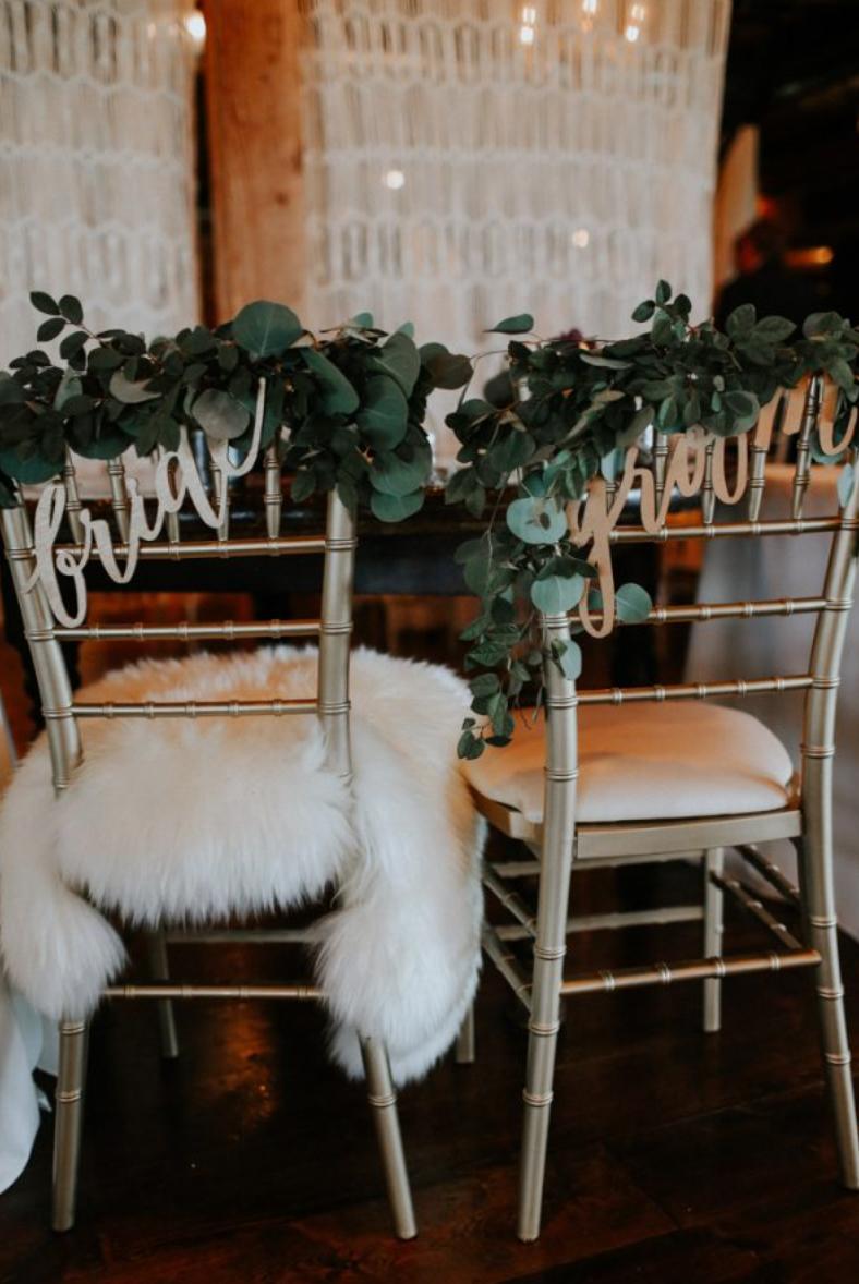 bride groom signs on seats at wedding reception