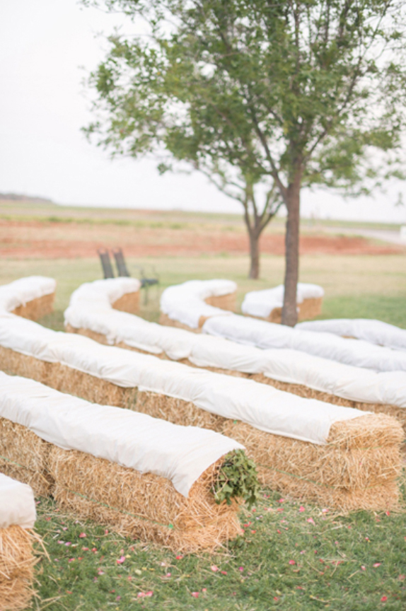 Country wedding with hay bale seating
