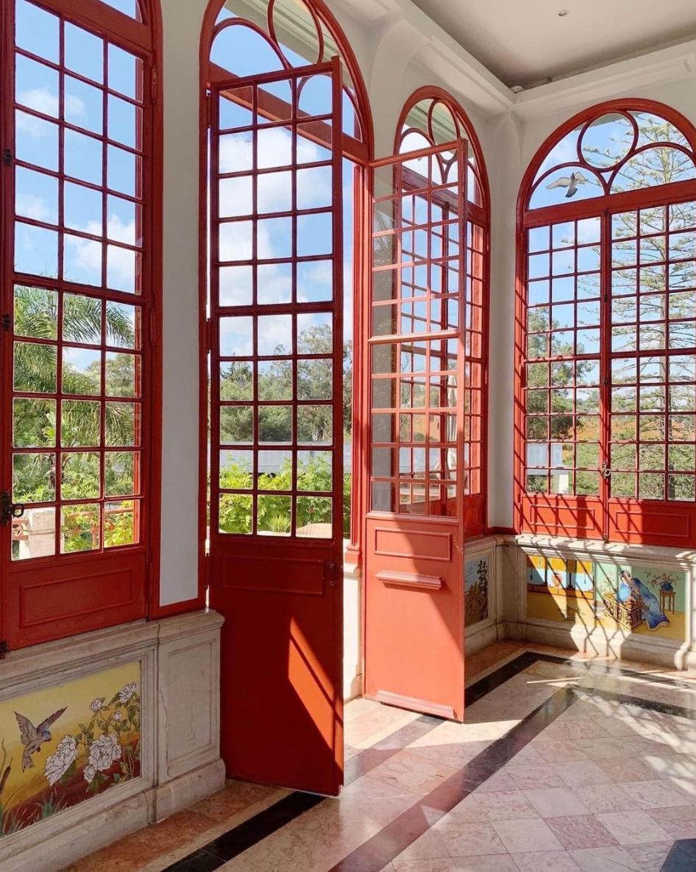 Sunroom with arch windows