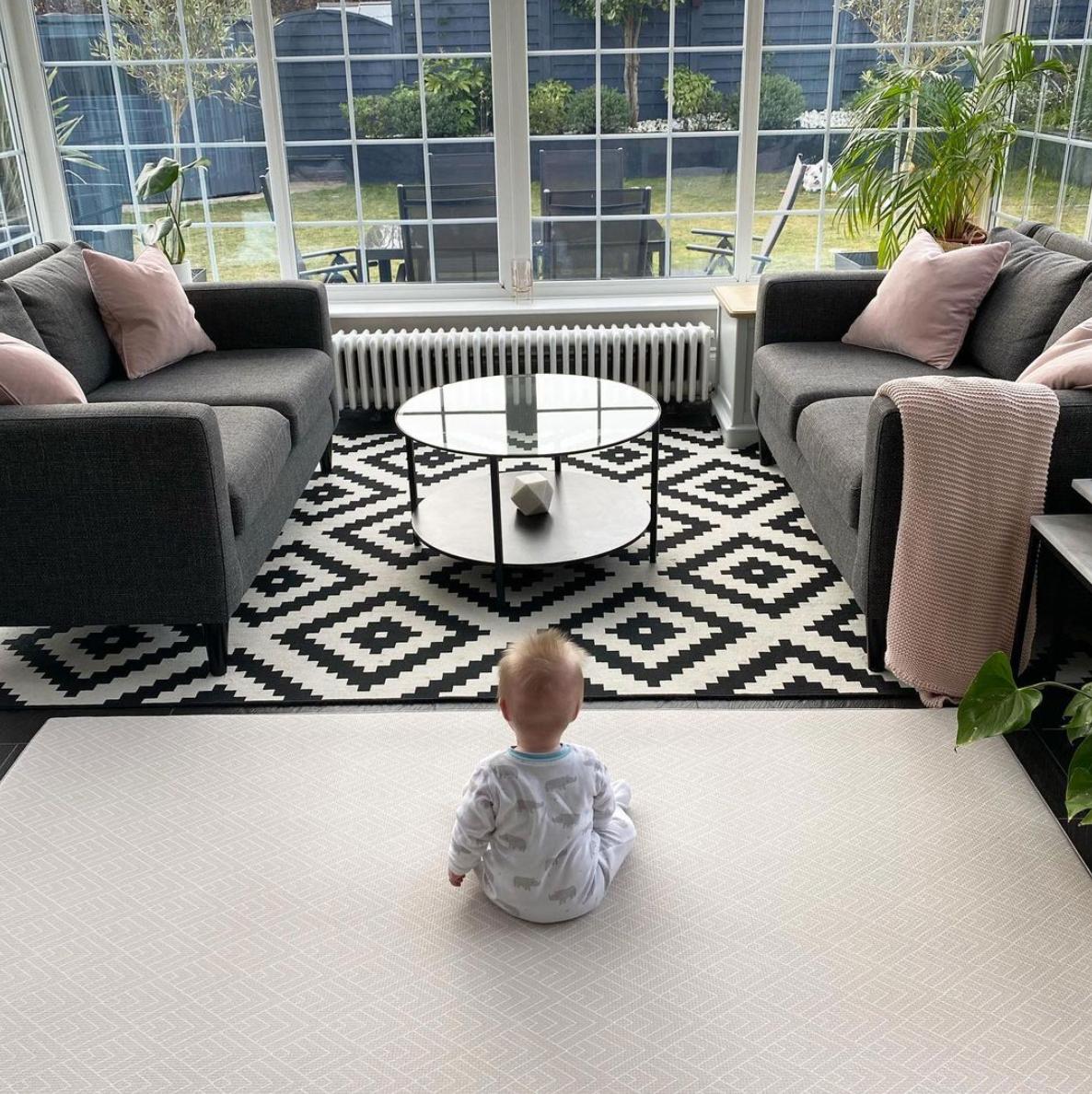 Modern sunroom with dark furniture