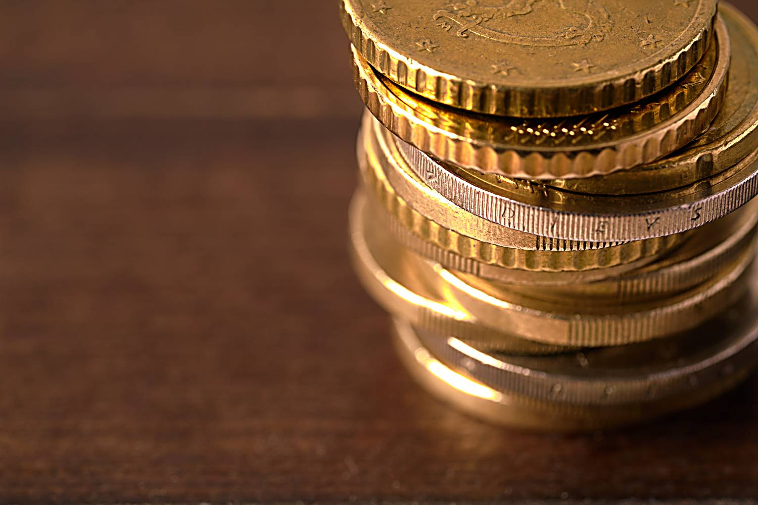 Euro coins stacked on each other in different positions