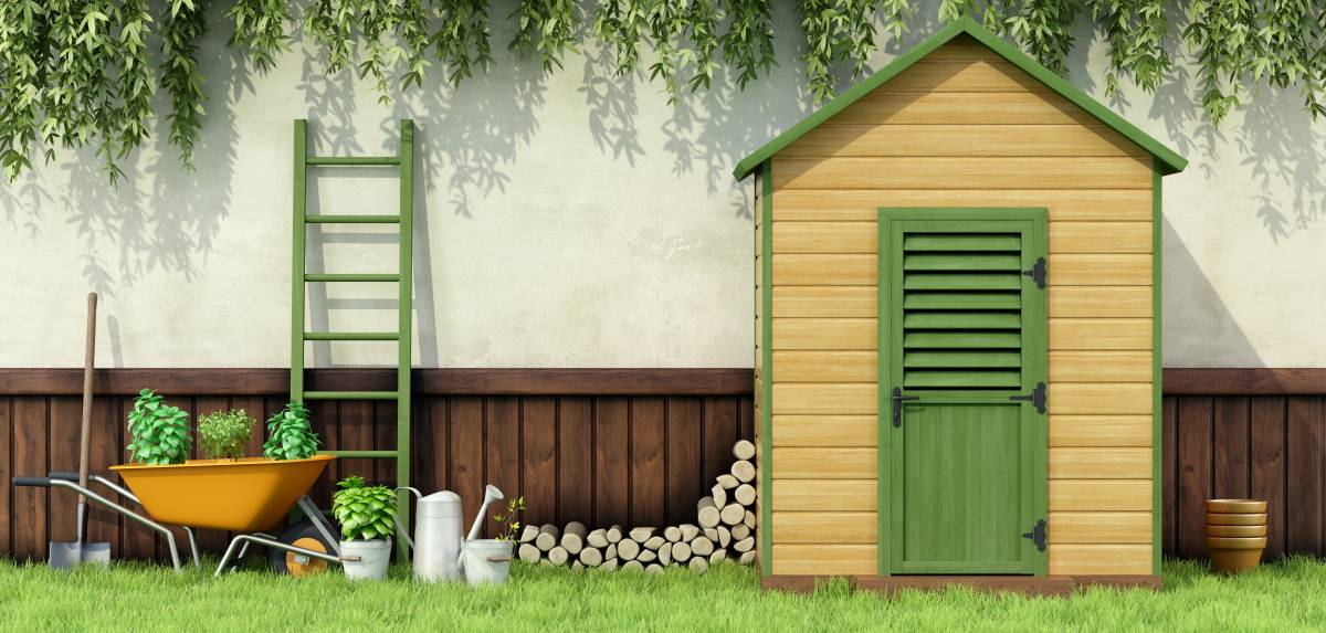 yellow and green garden shed with tools