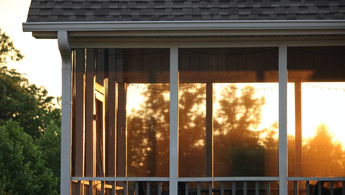 screened in porch with sunset