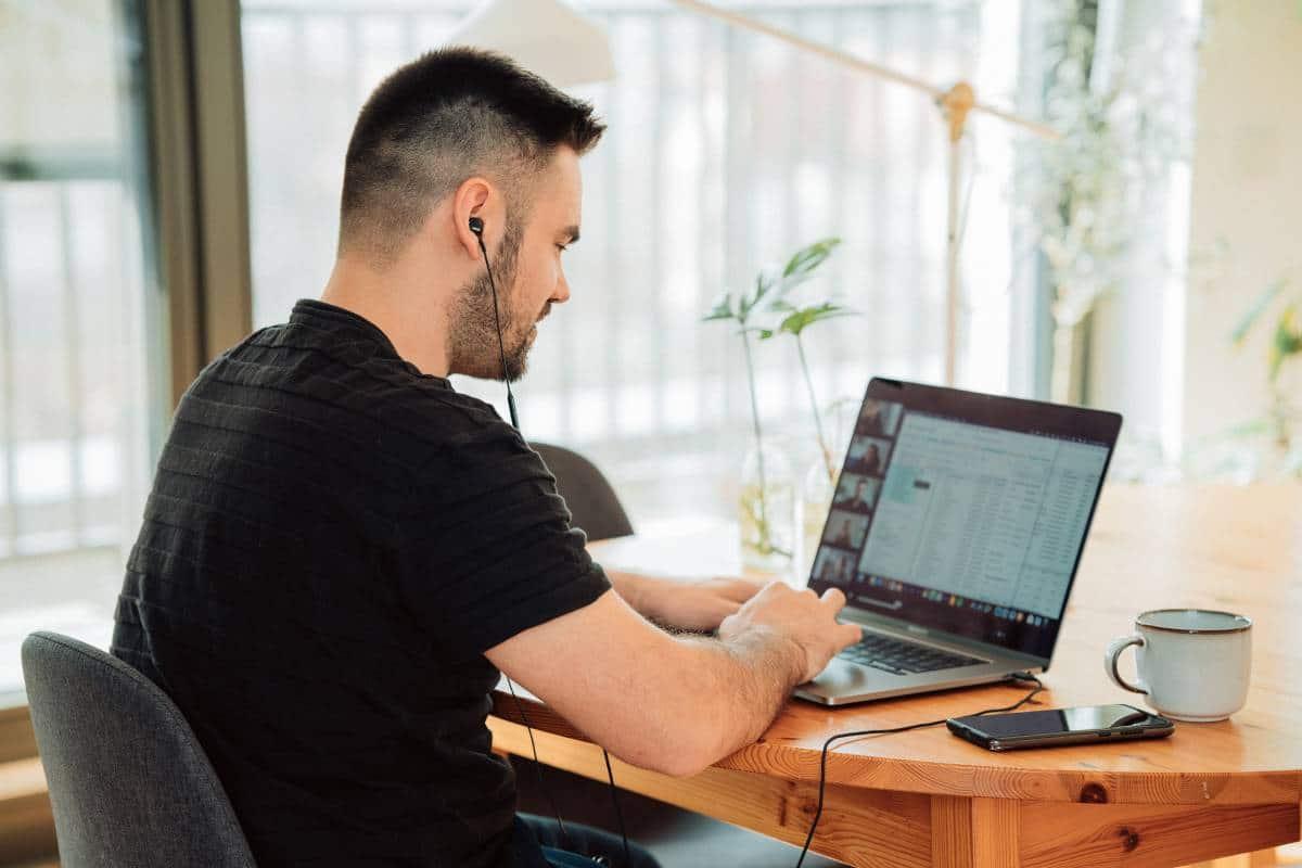 man attending an online meeting