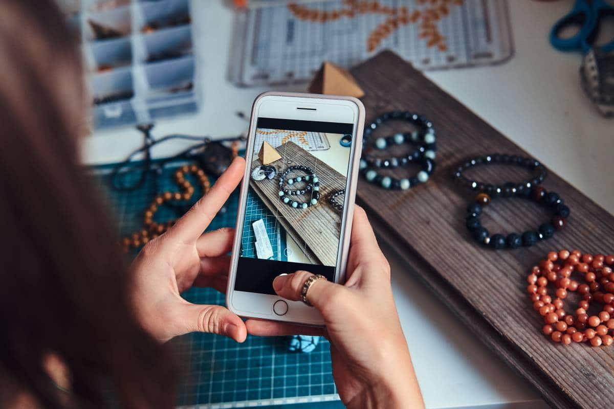 woman taking photos of handmade jewellery
