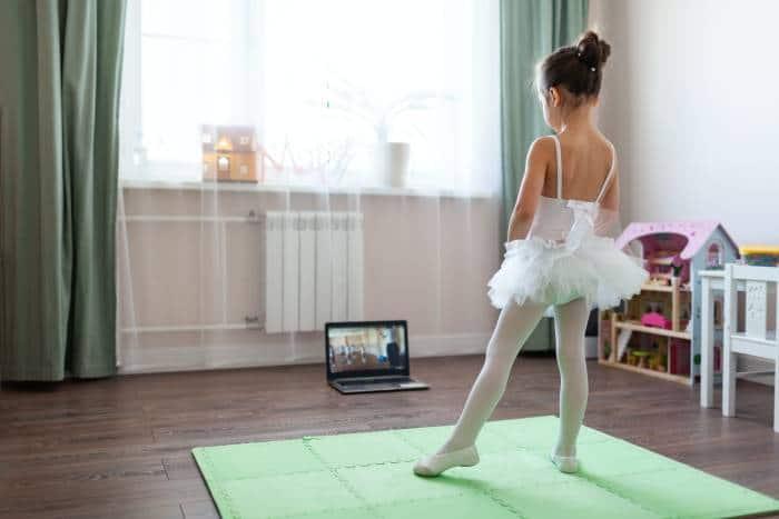 girl taking online ballet classes at home
