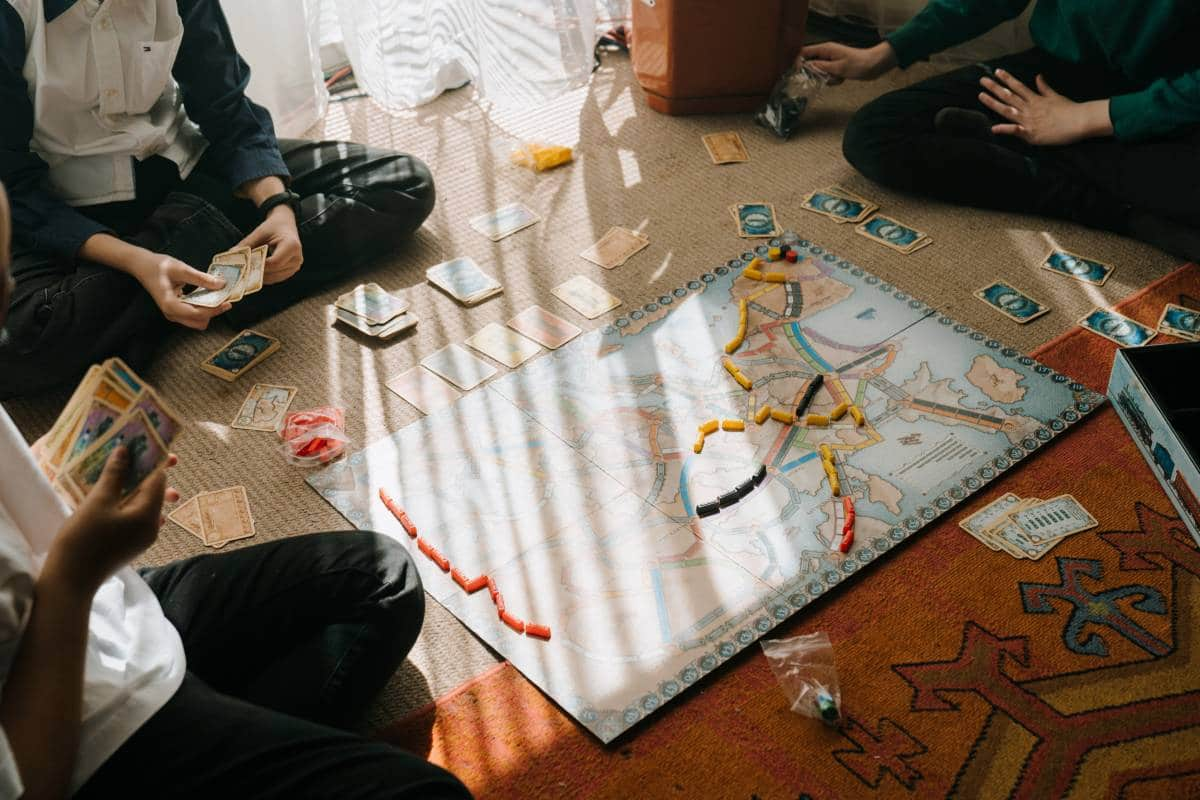 boys playing a board game indoors