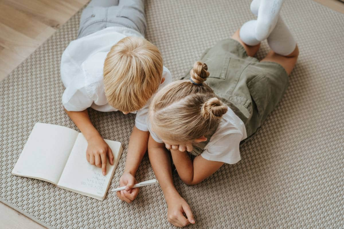 kids writing on notebook