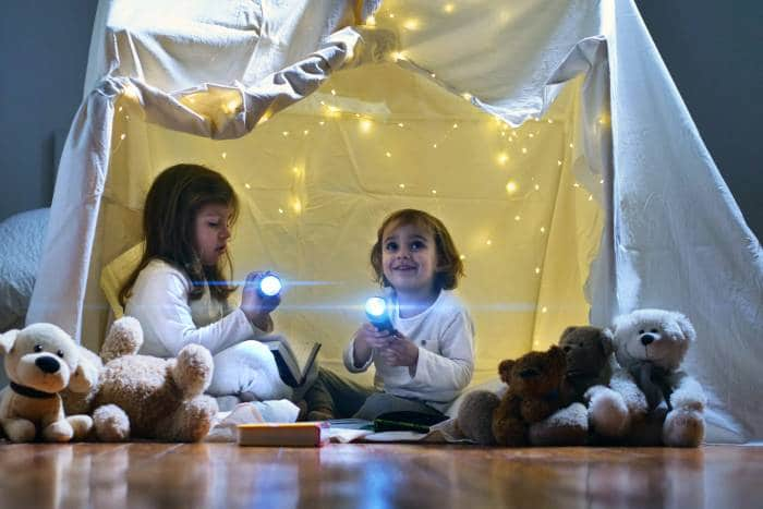 little girls inside indoor tent with lights