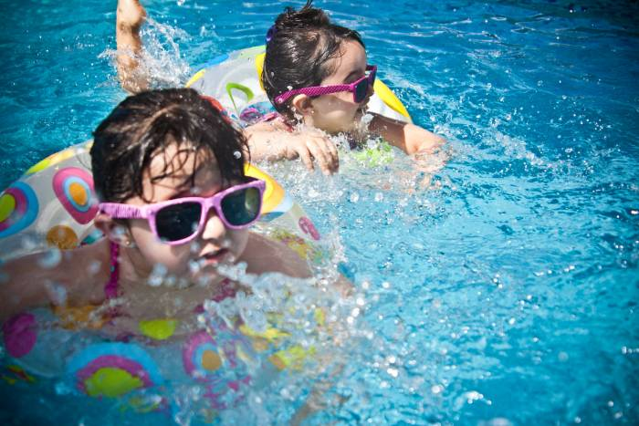 little gitls swimming in pool